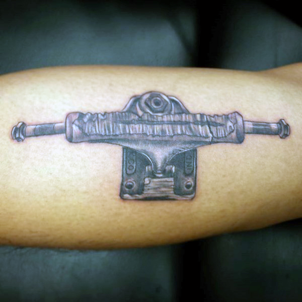 grinded-skateboard-trucks-mens-bicep-tattoo